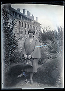 fashionable woman standing in the garden of a luxurious hotel France circa 1920s