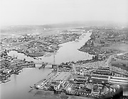deLay540000-2Seattle traffic spots. January 1954. The original Duwamish River Bridge, which was replaced by the First Avenue South Bridge. View looking south. Boeing Field on left.