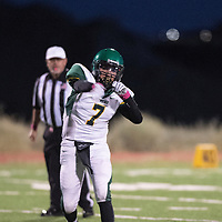 Bradley Largo, quarterback for the Thoreau Hawks throws a pass downfield against Tohatchi Cougars Friday Oct. 5, 2018 in Tohachi.