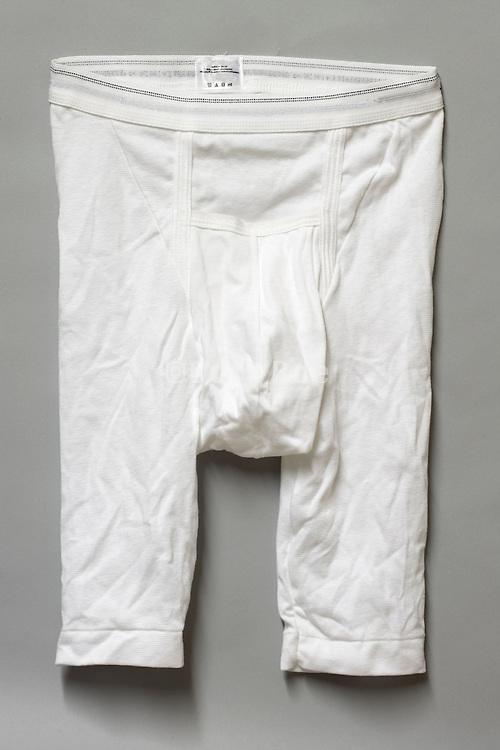white boxer briefs underwear against gray background