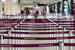 Edinburgh, Scotland, UK. 15 Feb 2021. From today Scottish Government requires all passengers from overseas arriving at Scottish airports to go into a mandatory quarantine in a hotel. Pic; Check-in counters are deserted in the terminal. Iain Masterton/Alamy Live news