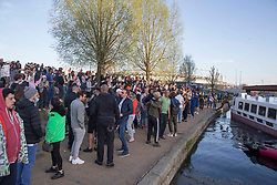 © Licensed to London News Pictures. 04/04/2021. London, UK. Members of the public party by the canal on Easter Sunday in Hackney Wick, east London. Photo credit: Marcin Nowak/LNP