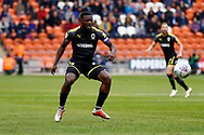 Wimbledon defender Adedeji Oshilaja (4) in action  during the EFL Sky Bet League 1 match between Blackpool and AFC Wimbledon at Bloomfield Road, Blackpool, England on 20 October 2018.