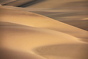 Shapes, shadows, curves, lines and textures define large sand dunes of the Skeleton Coast,Namibia