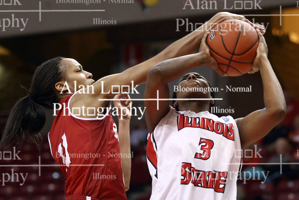 30 January 2015:  Tamya Sims gets a hand on the ball that Octavia Crump is trying to shoot during an NCAA women's basketball game between the Bradley Braves and the Illinois Sate Redbirds at Redbird Arena in Normal IL