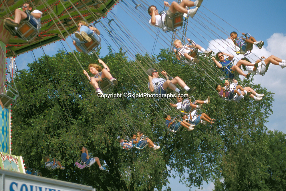 Minnesota State Fair elevated ride loaded with kids and family.  St Paul Minnesota USA