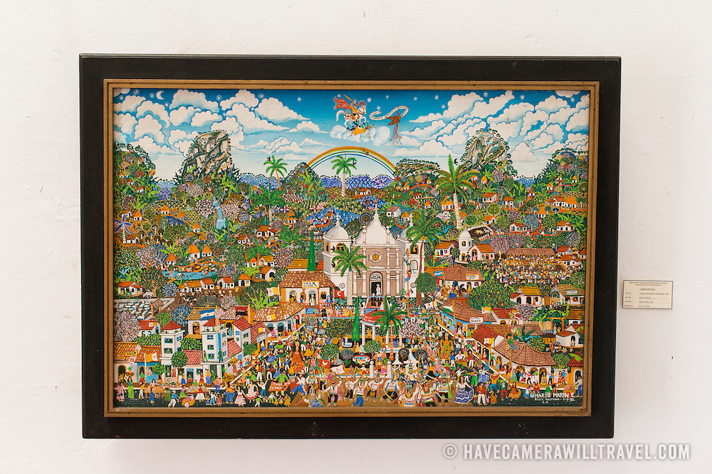The painting is titled Fiestas Patronales de Boaco, 1981, and was painted by Mario Marin. The The Centro Cultural Convento San Francisco, located just a couple of blocks from Parque Central in Granada, is dedicated to the history of the region.