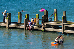 © Licenced to London News Pictures<br /> 02 July 2018 . Aberystwyth Wales UK<br /> <br /> UK Weather:  People at the seaside in Aberystwyth as the scorchingly hot  and very dry weather continues to dominate the UK.<br /> After a brief respite overnight, with some light rain, the searing heat has returned , with temperatures  again rising to the low 30º's this week<br /> <br /> photo credit Keith Morris / London News Pictures