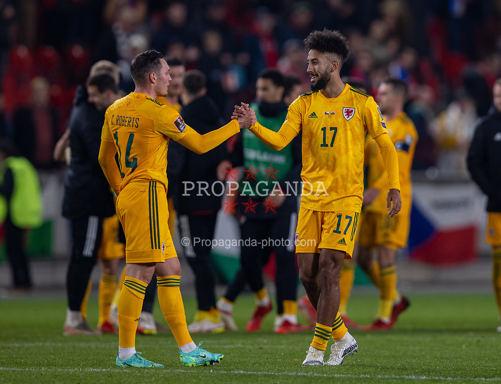 PRAGUE, CZECH REPUBLIC - Friday, October 8, 2021: Wales' Sorba Thomas (R) shakes hands with Connor Roberts after the FIFA World Cup Qatar 2022 Qualifying Group E match between Czech Republic and Wales at the Sinobo Stadium. The game ended in a 2-2 draw. (Pic by David Rawcliffe/Propaganda)