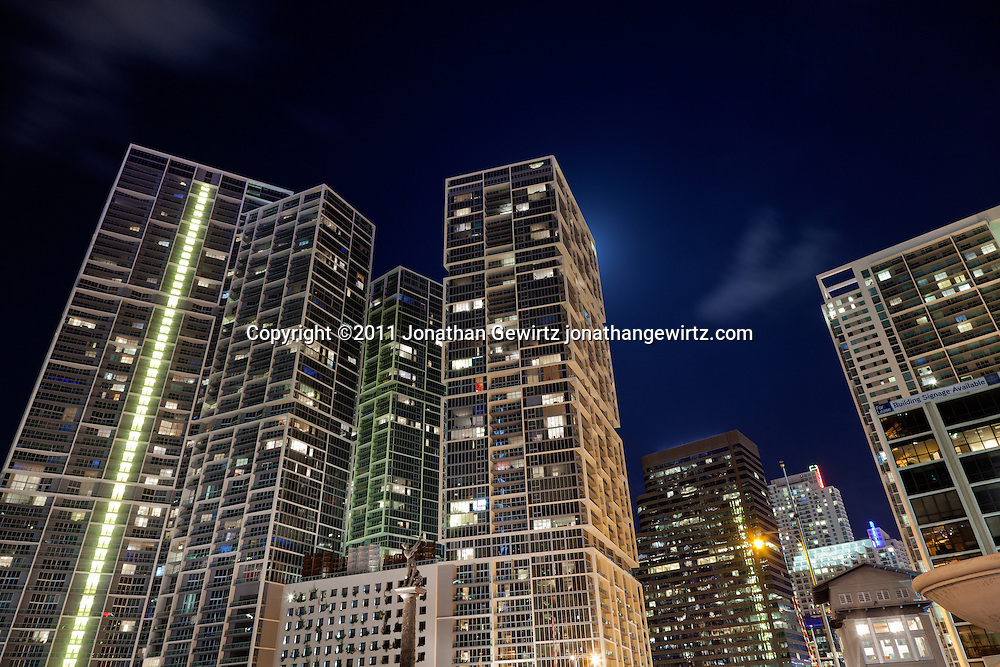 Night view of condo and office buildings, looking south along Miami's Brickell Avenue, one of its main commercial and residential thoroughfares. WATERMARKS WILL NOT APPEAR ON PRINTS OR LICENSED IMAGES.