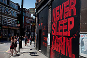 "Sign that reads ""Never Sleep Again"" outside the 333 night club in the trendy area of East London, Hoxton and Shoreditch. This is one of the most progressive and stylish areas in London."