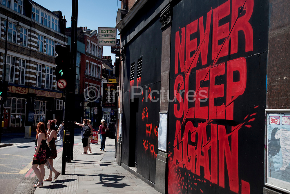 """Sign that reads """"Never Sleep Again"""" outside the 333 night club in the trendy area of East London, Hoxton and Shoreditch. This is one of the most progressive and stylish areas in London."""