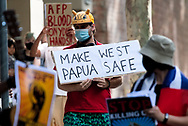 A sign that reads 'Make West Papua Safe' is seen being carried by a demonstrator during the AFP Stop Training Killers protest organised by Make West Papua Safe organisation. The organisation believes the AFP trains with Indonesian riot police BriMob and counter-terrorist police D88, who are reportedly notorious killers in West Papua, responsible for execution-style murders, torture and other crimes. (Photo by Mikko Robles/Speed Media)