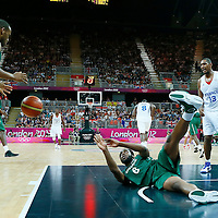 06 August 2012: Nigeria Ike Diogu passes the ball to Richard Oruche during 79-73 Team France victory over Team Nigeria, during the men's basketball preliminary, at the Basketball Arena, in London, Great Britain.