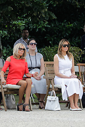 Brigitte Macron, wife of French President Emmanuel Macron, U.S. First Lady Melania Trump look at Basque dancers in the garden of the Villa Arnaga, House-museum of Edmond Rostand, during a visit on traditional Basque culture in Combo-les-Bains, near Biarritz as part of the G7 summit, August 25, 2019. Photo by Thibaud Moritz/ABACAPRESS.COM
