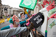 Extinction Rebellion 'Dirty Scrubbers' old fashioned washer women in curlers wash and launder their 'dirty money' and greenwash stains outside the Bank of England in the City of London financial district in a performance designed to highlight the corruption of big business and banking on 9th September 2020 in London, United Kingdom. The activists shouted out for people to come from the banks and to bring their dirty money to be cleaned in their washing machines. Extinction Rebellion is a climate change group started in 2018 and has gained a huge following of people committed to peaceful protests. These protests are highlighting that the government is not doing enough to avoid catastrophic climate change and to demand the government take radical action to save the planet.