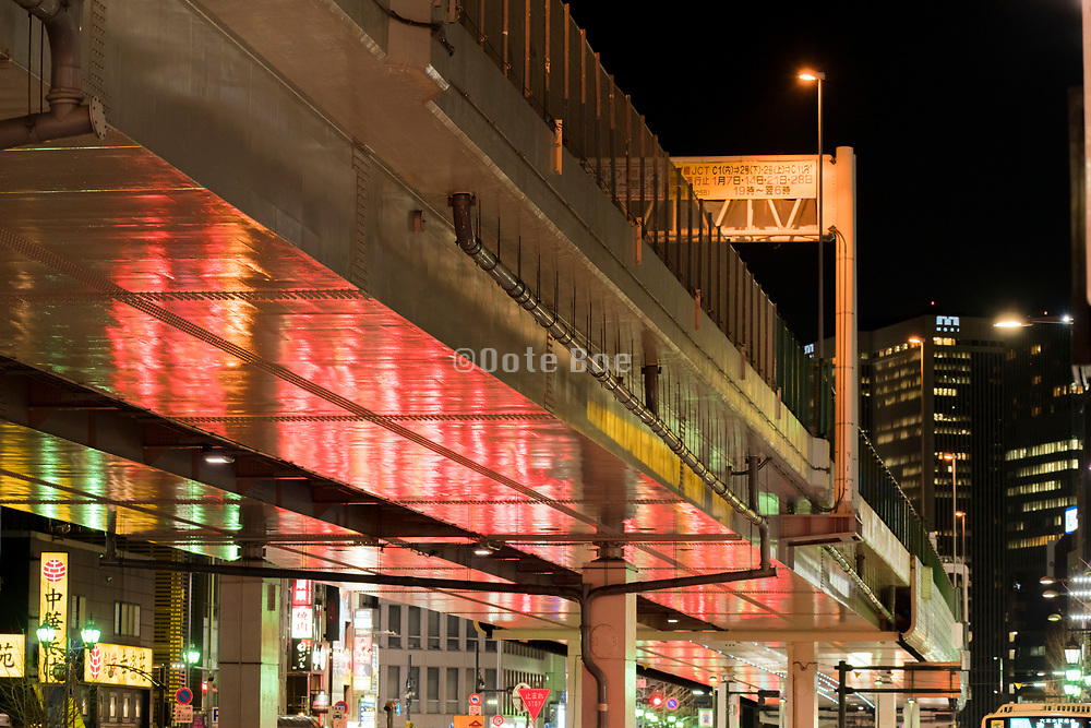 traffic light reflection under the express way in Tokyo Japan
