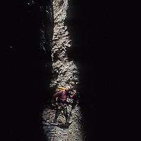 Mountaineer Mark Newcomb (MR) navigates treacherous slot canyons below Shipton's Arch in the Kara Tagh Mountains of Xinjiang, China.