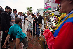 (c) under License to London News Pictures 02/11/2010. Racgoer gets a dancing a bit wildly as the band plays at the exit of the Flemington racecourse at the end of the 2010 Melbourne cup.