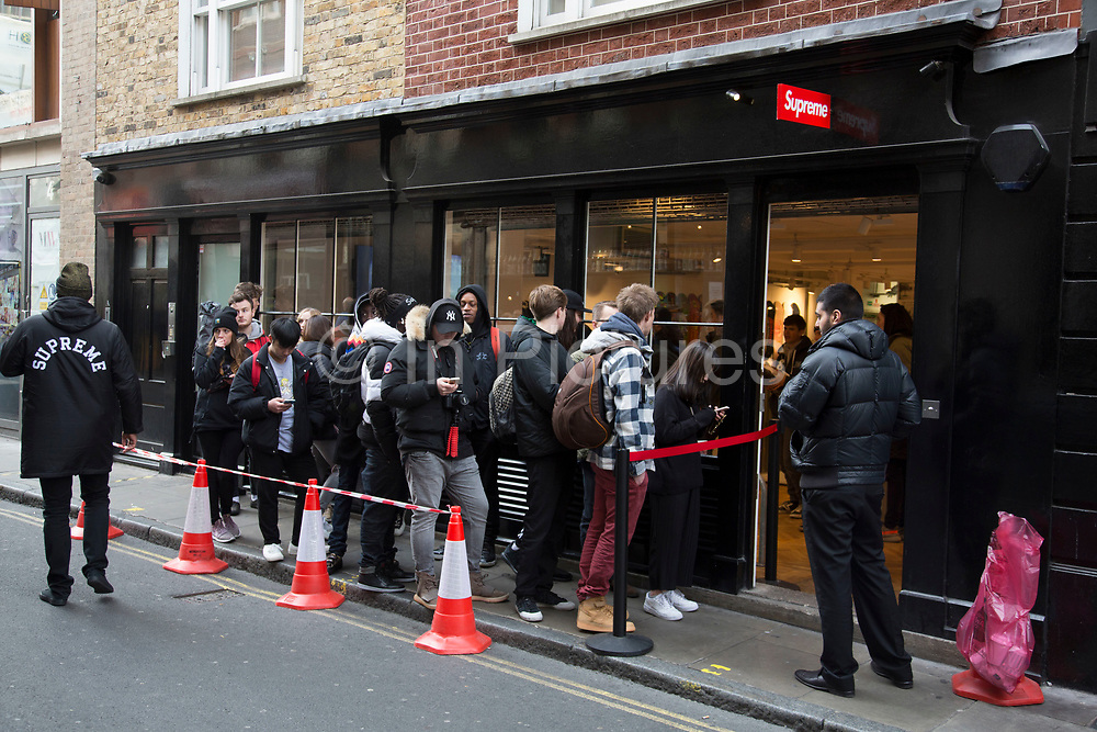 Every Thursday the fashion label Supreme, which is a skateboarding shop / clothing brand releases new lines and so fans of the brand queue outside this shop in Soho to be first in line for some original fashions in London, England, United Kingdom. (photo by Mike Kemp/In Pictures via Getty Images)