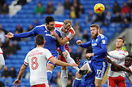 Cardiff City's Sean Morrison © heads home score his teams 1st goal while being challenged by Barnsley's Marc Roberts. EFL Skybet championship match, Cardiff city v Barnsley at the Cardiff city stadium in Cardiff, South Wales on Saturday 17th December 2016.<br /> pic by Carl Robertson, Andrew Orchard sports photography.