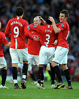 Fotball<br /> England<br /> Foto: Fotosports/Digitalsport<br /> NORWAY ONLY<br /> <br /> Wayne Rooney Celebrates Scoring 4th goal with team mates Patrice Evra and Michael Carrick<br /> Manchester United 2008/09<br /> Manchester United V Tottenham Hotspur (5-2) 25/04/09<br /> The Premier League