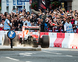 © Licensed to London News Pictures. 12/07/2017. London, UK. Formula One cars parade in Whitehall, central London ahead of this weekend's British Grand Prix. Photo credit: Rupert Frere/LNP