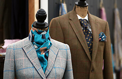 Suits for sale in a shopping stall at Cheltenham racecourse