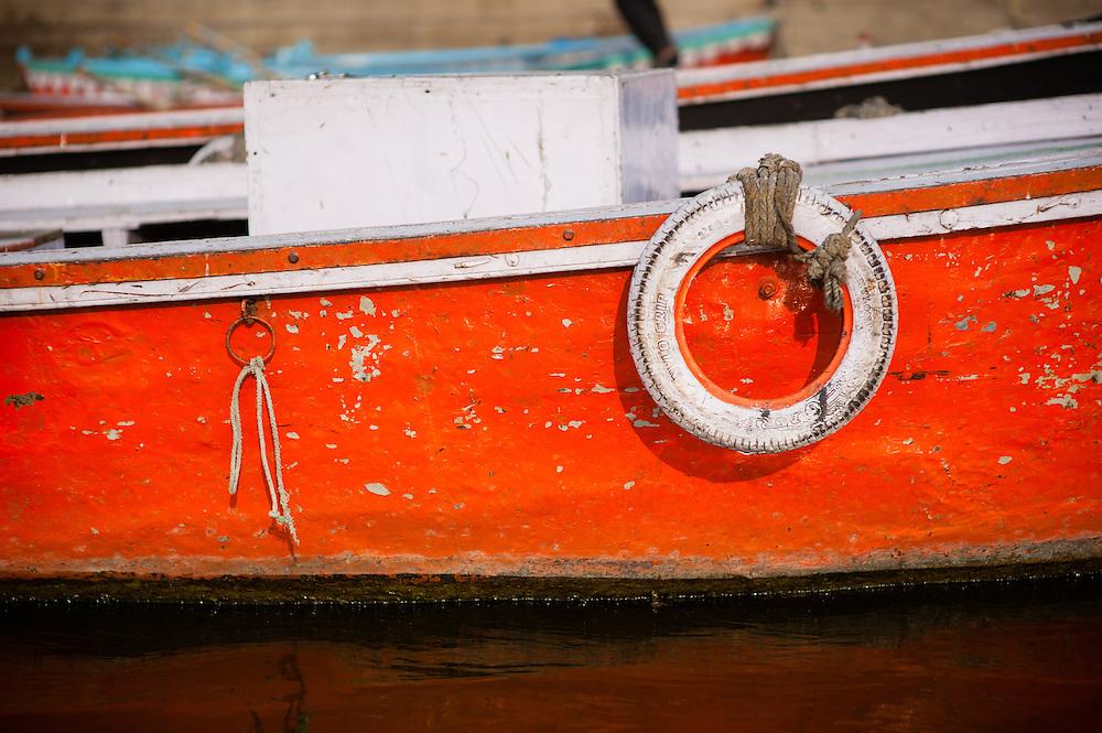 Red boat in Varanasi (India)