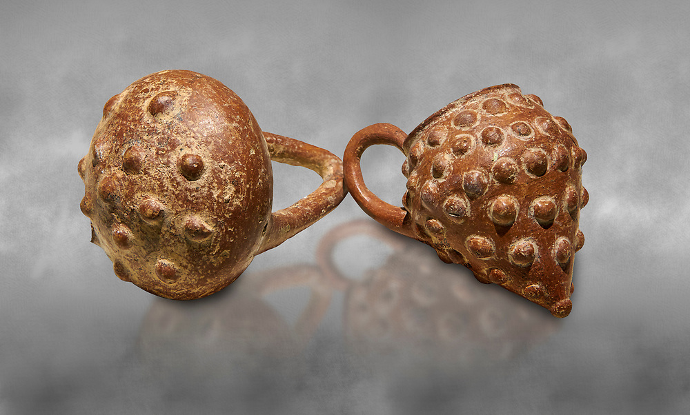 Bronze Age Anatolian terra cotta basket with handle & a beaker shaped as a bunch of grapes - 19th to 17th century BC - Kültepe Kanesh - Museum of Anatolian Civilisations, Ankara, Turkey. .<br /> <br /> If you prefer to buy from our ALAMY PHOTO LIBRARY  Collection visit : https://www.alamy.com/portfolio/paul-williams-funkystock/kultepe-kanesh-pottery.html<br /> <br /> Visit our ANCIENT WORLD PHOTO COLLECTIONS for more photos to download or buy as wall art prints https://funkystock.photoshelter.com/gallery-collection/Ancient-World-Art-Antiquities-Historic-Sites-Pictures-Images-of/C00006u26yqSkDOM