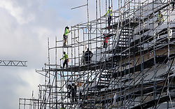 Construction workers dismantle scaffolding that encompasses a yacht under construction at Harbor Towne Marina in Dania Beach ahead of Hurricane Irma. (Photo by Mike Stocker /Sun Sentinel/TNS/Sipa USA)<br />