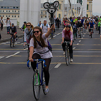Girl holds the symbol of the Critical Mass ride around the city on Earth Day that is demonstrating the importance and popularity of bicycle as a mean of everyday city transportation in Budapest, Hungary on April 22, 2012. ATTILA VOLGYI