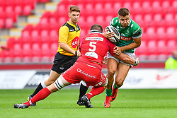 Luca Sperandio of Benetton Treviso is tackled by Steven Cummins of Scarlets<br /> <br /> Photographer Craig Thomas/Replay Images<br /> <br /> Guinness PRO14 Round 3 - Scarlets v Benetton Treviso - Saturday 15th September 2018 - Parc Y Scarlets - Llanelli<br /> <br /> World Copyright © Replay Images . All rights reserved. info@replayimages.co.uk - http://replayimages.co.uk