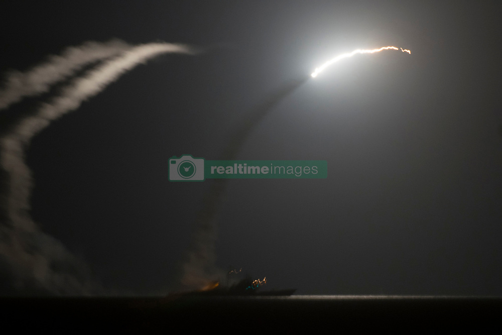 April 6, 2017 -  (File Photo) - The U.S. military launched a military strike with approximately 50 cruise missiles at a Syrian military airfield late on Thursday, in retaliation for their chemical weapon attack on civilians earlier in the week. PICTURED - Sep 23, 2014 - Arabian Gulf - The guided-missile cruiser USS Philippine Sea (CG 58) launches a Tomahawk cruise missile to conduct strikes against ISIL targets as seen from the aircraft carrier USS George H.W. Bush (CVN 77). George H.W. Bush and Philippine Sea are part of Carrier Strike Group 2, supporting maritime security operations and theater security cooperation efforts in the U.S. 5th Fleet area of responsibility. The US and five Arab allies have launched the first strikes against Islamic State (IS) militants in Syria. (Credit Image: © Eric Garst/U.S. Navy/ZUMAPRESS.com)