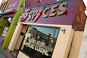 "The 5 Spices restaurant on Gerrard Street in Toronto's Indian Bazaar neighborhood, advertising ""Indian syle Chinese cuisine."""