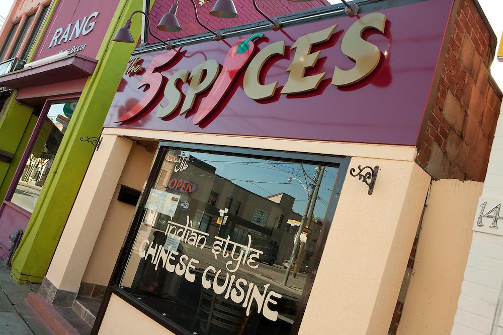 "The 5 Spices restaurant on Gerrard Street in Toronto's Indian Bazaar neighborhood, advertising ""Indian syle Chinese cuisine."""