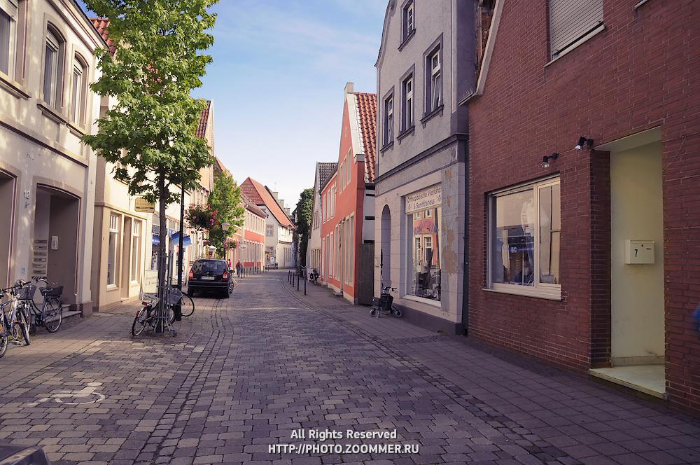 Street of typical small German town Warendorf, empty brick street.