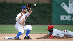 July 21, 2017 - Chicago, IL, USA - Chicago Cubs second baseman Ben Zobrist (18) catches the throw as St. Louis Cardinals center fielder Dexter Fowler (25) dives for a steal in the sixth inning on Friday, July 21, 2017 at Wrigley Field in Chicago, Ill. (Credit Image: © John J. Kim/TNS via ZUMA Wire)