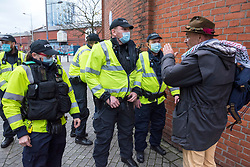 © Licensed to London News Pictures; 14/11/2020; Bristol, UK. A man remonstrates with Police after they arrest a woman who was at the front of an Anti-Lockdown protest march and rally by Stand Up Bristol and StandUpX2, against the Covid-19 lockdown during the coronavirus pandemic, taking place on College Green in front of Bristol City Hall. Protests have been declared illegal under the current Covid-19 lockdown as people are not allowed to meet in more than groups of two and police have threatened arrests and fines against those attending. Police arrested several people. The protest is against Lockdowns, Isolation of the Elderly, Ruined Childhoods, Business Closures, Masks, Government Interference in Private Life and is part of a series of protests today in Sheffield, Wolverhampton, Portsmouth, Bristol and Bournemouth. England is under a national lockdown, sometimes known as lockdown 2.0, as the UK Government tries to stop the spread of the covid-19 coronavirus pandemic. From 05 November lockdown restrictions came into force across England with all pubs, bars, restaurants and entertainment venues shut as well as all non-essential shops. People have been told to stay at home except for work, education, exercise or essential shopping and each person can only meet one other person from outside their household in an outdoors public space. Photo credit: Simon Chapman/LNP.
