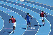 Kenan Christon of Southern California (left), Davonte Burnett of UCLA (center) and Nicholas Ramey of Southern California run in the 200m during a dual meet at Drake Stadium, Sunday, May 2, 2021, in Los Angeles. (Kirby Lee via Image of Sport)