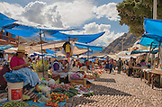 The Sunday market in Pisac is a lively place.  There is a craft market that is open everyday for the tourists, but the Sunday market is all local.  The Quechua still barter with their produce to acquire needed food and supplies.