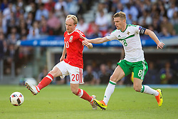 PARIS, FRANCE - Saturday, June 25, 2016: Wales' Jonathan Williams in action against Northern Ireland's Steven Davis during the Round of 16 UEFA Euro 2016 Championship match at the Parc des Princes. (Pic by Paul Greenwood/Propaganda)