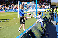 Sheffield Wednesday midfielder Barry Bannan (41) gives his boots to a young fan after the Sky Bet Championship match between Sheffield Wednesday and Cardiff City at Hillsborough, Sheffield, England on 30 April 2016. Photo by Ellie Hoad.
