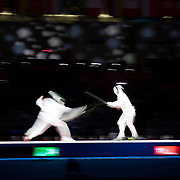 TOKYO, JAPAN - JULY 30:  Satoru Uyama of Japan (left) in action against Sergey Bida of ROC during the Japan V ROC gold medal match won by Japan 45-36  during the fencing epee team event for men at the Makuhari Messe at the Tokyo 2020 Summer Olympic Games on July 30, 2021 in Tokyo, Japan. (Photo by Tim Clayton/Corbis via Getty Images)