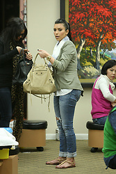 Kim Kardashian goes to Bedfordnail salon in Beverly Hills, Los Angeles, CA, USA on March 23, 2011 for some quick manicure with her friend where she tries her new purse then heads to Ralph Lauren for some last minute shopping. Photo by GG/ABACAPRESS.COM  | 268531_005 Los Angeles u Etats-Unis United States