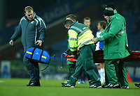 Photo: Paul Greenwood/Sportsbeat Images.<br />Blackburn Rovers v Arsenal. Carling Cup, Quarter Final. 18/12/2007.<br />Arsenal's Nacer Barazite is stretchered off as he is given oxygen by a member of the Blackburn medical team.