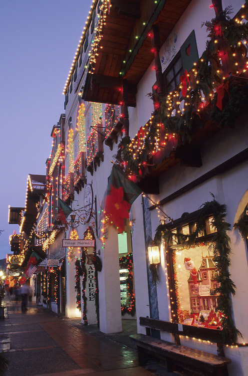 North America, USA, Washington, Leavenworth. Christmas lights glow on Front Street during annual Christmas festival