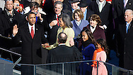 Barack Obama takes the oath of office at the swearing in ceremony during the Inauguration on January 20, 2009.  Photograph:  Dennis Brack