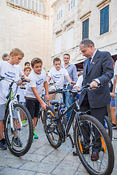 "27.09.2013, Stradun, Dubrovnik, CRO, FIA Action for Road Safety, im Bild FIA Praesident Jean Todt in Dubrovnikim Rahmen des FIA Action Road Safety Tages. Mitglieder des Lokalen Automobil Clubs und Kinder trainierten auf Fahrrädern // In front of the Rector's Palace Jean Todt visited event ""FIA Action for Road Safety."" It was attended by members of the Automobile Club Dubrovnik racing and city kids who competed in the training area on bicycles. The whole operation came as support of president of FIA Jean Todt and the Chairmen of the global automotive organization, as well as Mayor Andro Vlahusic. Sradun, Dubrovnik, Croatia on 2013/09/27. EXPA Pictures © 2013, PhotoCredit: EXPA/ Pixsell/ Grgo Jelavic<br /> <br /> ***** ATTENTION - for AUT, SLO, SUI, ITA, FRA only *****"