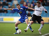 Mllwall's David martin battles with derby's Kris Commons<br /> F.A. Cup Third Round. Millwall v Derby County. 02.01.10<br /> Photo By Karl Winter Fotosports International